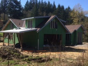 Roofing is mostly on. We put plastic over the windows to keep out any wind blown rain until the windows show up