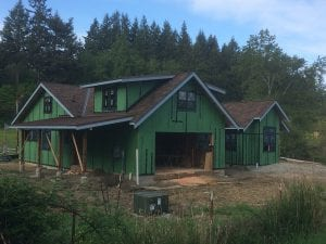 Metal roofing was used on the shallow slope roofs. And the windows are in now too!